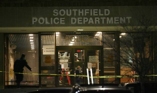 Caution tape blocks the entrance of the Southfield Police Department, Sunday, Nov. 11, 2012 in Southfield, Mich. Southfield Police in say a man who opened fire in a police station was killed in a shootout with officers. (AP Photo/Detroit Free Press, Mandi Wright)