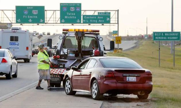 A wrecker operator tows a car that went into the Oklahoma River just west of Eastern Ave. in Oklahoma City Tuesday, July 15, 014. One person was in the car when it went into the river and was transported by ambulance. Photo by Paul B. Southerland, The Oklahoman