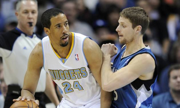 Denver Nuggets guard Andre Miller (24) is pressured by Minnesota Timberwolves guard Luke Ridnour (13) during the first quarter of an NBA basketball game on Thursday, Jan. 3, 2013, in Denver. (AP Photo/Jack Dempsey)