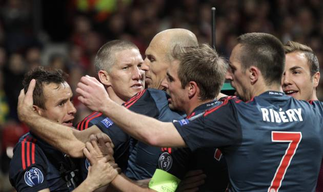 Bayern's Bastian Schweinsteiger, second left, celebrates with his teammates after scoring their side's first goal during the Champions League quarterfinal first leg soccer match between Manchester United and Bayern Munich at Old Trafford Stadium, Manchester, England, Tuesday, April 1, 2014.(AP Photo/Jon Super)