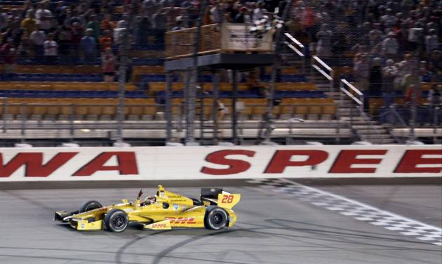 Ryan Hunter-Reay crosses the finish line to win the Indy Car series event in Newton Iowa Saturday July 12, 2014. (AP Photo/Justin Hayworth)