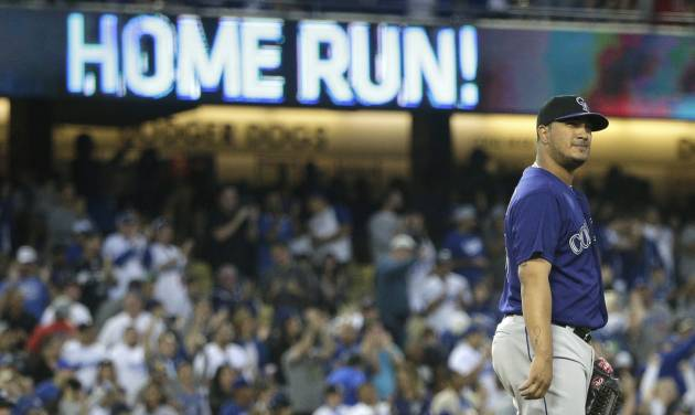 Colorado Rockies starting pitcher Jhoulys Chacin stands on the mound after giving up a two-run home run to Los Angeles Dodgers' Hanley Ramirez during the third inning of a baseball game on Tuesday, June 17, 2014, in Los Angeles. (AP Photo/Jae C. Hong)