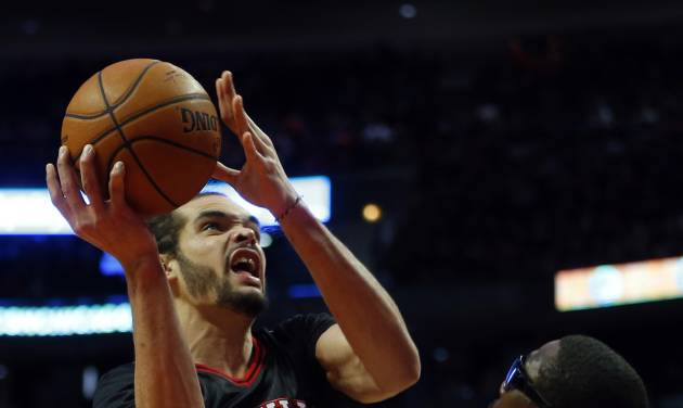 Chicago Bulls center Joakim Noah, left,shoots over New York Knicks power forward Amar'e Stoudemire (1) during the second half of an NBA basketball game on Sunday, March 2, 2014, in Chicago. The Bulls won the game 109-90. (AP Photo/Jeff Haynes)