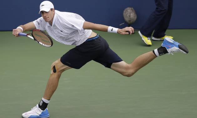John Isner, of the United States, follows through on a shot against Philipp Kohlschreiber, of Germany, during the third round of the 2014 U.S. Open tennis tournament, Saturday, Aug. 30, 2014, in New York. (AP Photo/Darron Cummings)