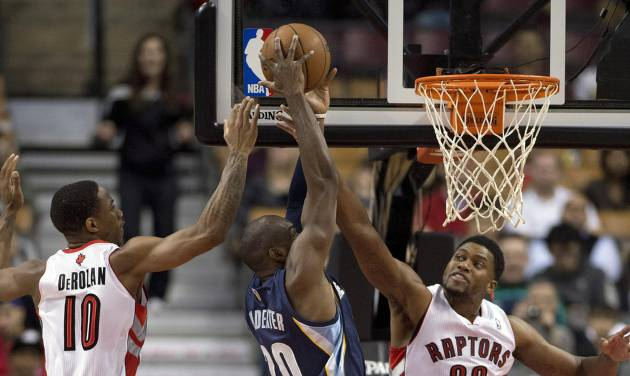 Memphis Grizzlies' Quincy Pondexter, center, tries to shoot with Toronto Raptors' DeMar DeRozan (10) and Rudy Gay (22) defending during the first half of a preseason NBA basketball game in Toronto on Wednesday, Oct. 23, 2013. (AP Photo/The Canadian Press, Frank Gunn)
