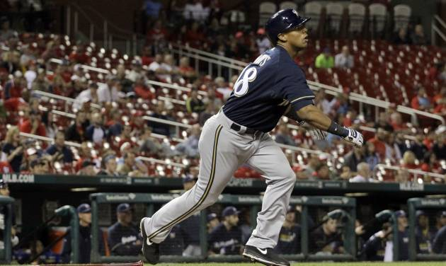 Milwaukee Brewers' Khris Davis watches his RBI triple during the 12th inning of a baseball game against the St. Louis Cardinals Monday, April 28, 2014, in St. Louis. The Brewers won 5-3 in 12 innings. (AP Photo/Jeff Roberson)