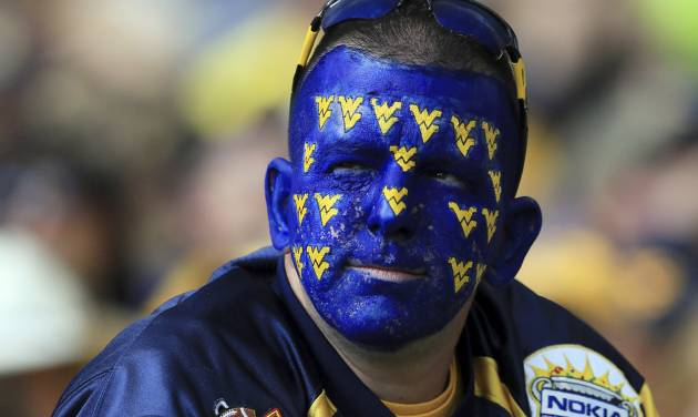 A West Virginia football fan looks on in the crowd during a Sept. 22 game against Maryland in Morgantown, W.Va., With the Mountaineers joining the Big 12, WVU officials have asked fans to tone down their behavior and make Morgantown more hospitable for visitors. (AP Photo/Christopher Jackson)
