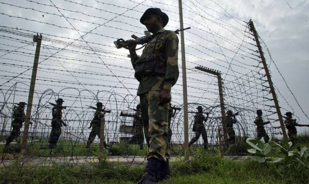 FILE - In this July 17, 2006 file photo, Border Security Force soldiers patrol the India-Pakistan border at Kanachak, about 15 kilometers (9 miles) west of Jammu, India. Pakistan and India traded accusations Sunday, Jan. 6, 2013, of violating the cease-fire in the disputed northern region of Kashmir, with Islamabad accusing Indian troops of a cross-border raid that killed one of its soldiers and India charging that Pakistani shelling destroyed a home on its side. (AP Photo/Channi Anand, File)