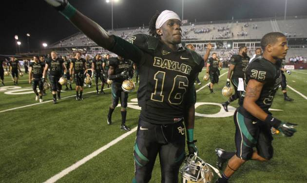 Baylor wide receiver Tevin Reese, left, walks off the field with teammate  Jemarcus Johnson, right, following their 47-42 win over  Louisiana-Monroe,  Sept. 21, 2012 in Monroe, La. Reese and the Bears could have West Virginia on upset alert Saturday in Morgantown, W.Va. (AP Photo/Waco Tribune Herald, Duane A. Laverty).