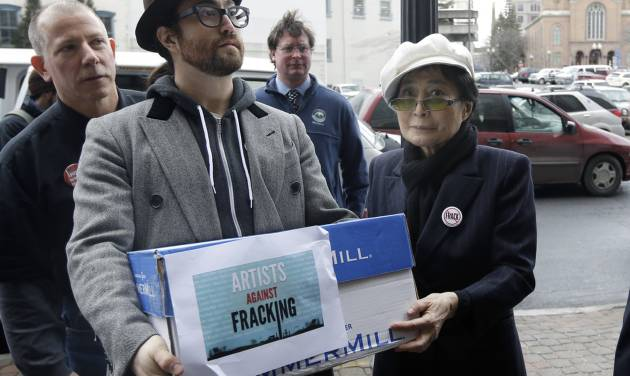"Sean Lennon and Yoko Ono help deliver boxes of comments to the New York State Department of Environmental Conservation on its proposed natural gas drilling regulations on Friday, Jan. 11, 2013, in Albany, N.Y. Environmental, health and community groups opposed to shale gas drilling and hydraulic fracturing, or ""fracking,"" say they collected more than 200,000 comments during an intense 30-day effort featuring online coaching and comment-writing workshops at churches, community centers, food co-ops, coffee shops and holiday house parties from New York City to Buffalo. (AP Photo/Mike Groll)"
