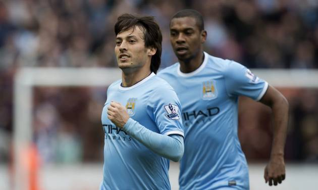 Manchester City's David Silva celebrates after scoring against Hull City during their English Premier League soccer match at the KC Stadium, Hull, England, Saturday March 15, 2014. (AP Photo/Jon Super)