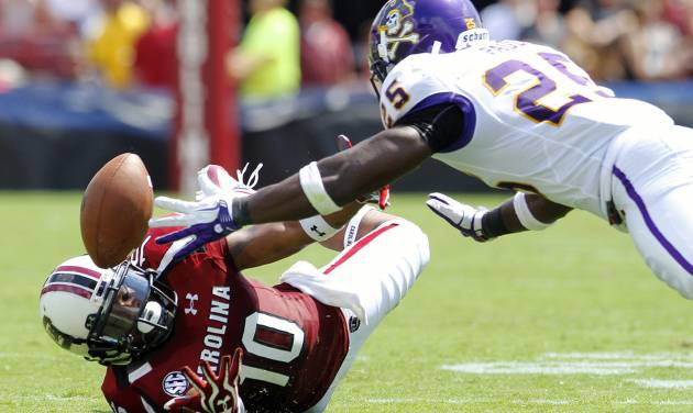 South Carolina wide receiver Nick Jones, left, and East Carolina defensive back Leonard Paulk, right, dive for a pass from South Carolina quarterback Dylan Thompson during first half of their NCAA college football game in Columbia, S.C., Saturday, Sept. 8, 2012. (AP Photo/Brett Flashnick)