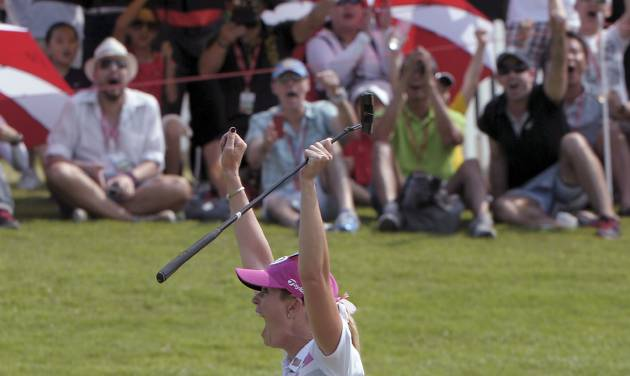 Paula Creamer of the U.S. celebrates as she won the HSBC Women's Champions golf tournament in Singapore on Sunday, Mar. 2, 2014. (AP Photo/Joseph Nair)