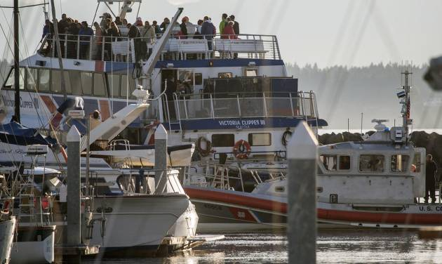 A Victoria Clipper returns to the dock after an engine fire, Friday, June 14, 2013 in Ballard, Wash. A Seattle Fire Department spokesman says more than 150 passengers have been safely evacuated from a tour ship that reported an engine fire and docked Friday night at a Seattle marina. (AP Photo/The Seattle Times, Dean Rutz)  MAGS OUT; NO SALES; SEATTLEPI.COM OUT; MANDATORY CREDIT