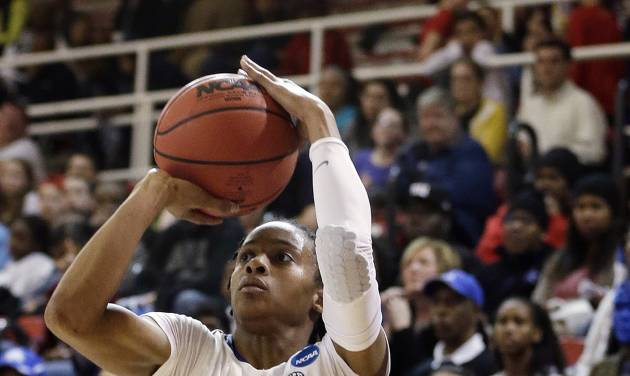 Kentucky's A'dia Mathies shoots a 3-point basket in the second half of a second-round game against Dayton in the NCAA women's college basketball tournament Tuesday, March 26, 2013, in New York. Kentucky won 84-70. (AP Photo/Frank Franklin)