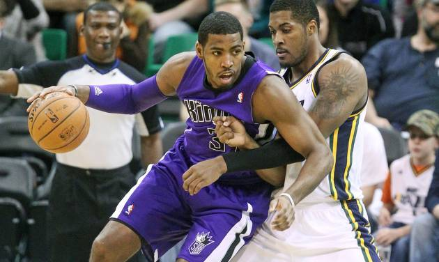 Utah Jazz's Derrick Favors, right, defends against Sacramento Kings' Jason Thompson, left, as he makes a drive in the first half of an NBA basketball game Monday, Jan. 27, 2014, in Salt Lake City. (AP Photo/Rick Bowmer)