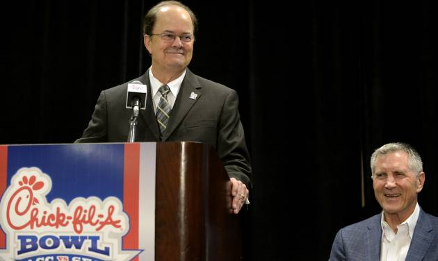 Duke head coach David Cutcliffe, left, smiles next to former coach Bill Curry as Cutcliffe accepts the Bobby Dodd Coach of the Year on Monday, Dec. 30, 2013, in Atlanta. Cutcliffe, who led Duke to its first 10-win season and a spot in the ACC championship game, will face Texas A&M in the Chick-fil-A Bowl on Tuesday night. (AP Photo/David Tulis)