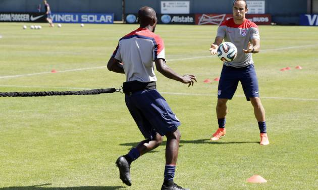 United States' Landon Donovan, right, and DaMarcus Beasley take part in drills during training in preparation for the World Cup soccer tournament on Wednesday, May 21, 2014, in Stanford, Calif. (AP Photo/Marcio Jose Sanchez)