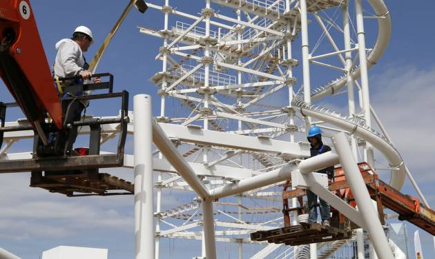 Workers assemble components of the landing area for the Sky Zip, a 700-foot zip line designed to take people from top of SandRidge Sky Trail (seen in the background) across the Oklahoma River and back again.                                        Photo by Paul Hellstern, The Oklahoman