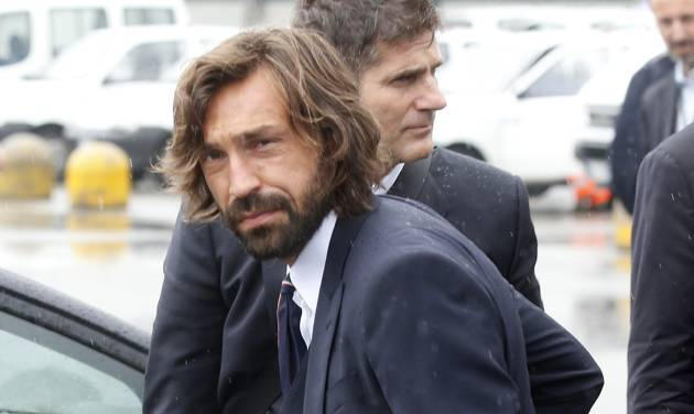 Italy soccer player Andrea Pirlo carries his luggage upon his arrival with his teammates at Malpensa airport after landing from Brazil, in Milan, Italy, Thursday, June 26, 2014. Italy was disqualified from the World Cup after loosing to Uruguay in their group stage round. Pirlo recently quit the national team. Pirlo had said before the tournament he would quit international football after Brazil. (AP Photo/Luca Bruno)