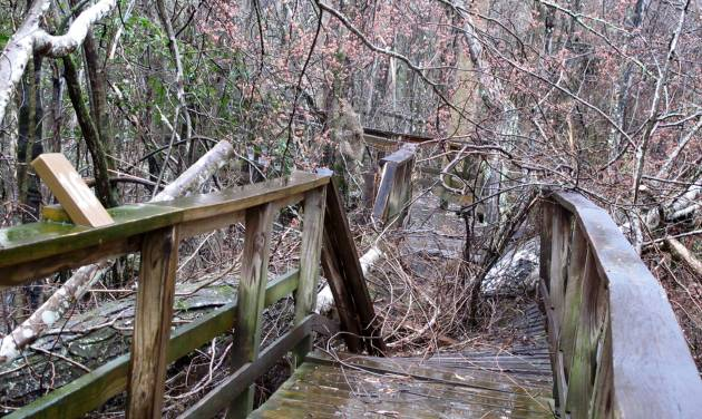 The shattered boardwalk at the Congaree National Park near Columbia, S.C., is seen on Friday, Feb. 21, 2013. The boardwalk was damaged in an ice storm that moved through South Carolina Feb. 11-13. The storm, the worst in the state in a decade, caused widespread damage at the park, the only national park in the state, and has  closed sections of the park's popular boardwalk.  (AP Photo/Bruce Smith)