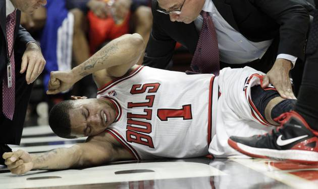 Chicago Bulls guard Derrick Rose (1) reacts after an injury during the fourth quarter of Game 1 in the first round of the NBA basketball playoffs against the Philadelphia 76ers in Chicago, Saturday, April 28, 2012. The Bulls won 103-91. (AP Photo/Nam Y. Huh) ORG XMIT: CXA107