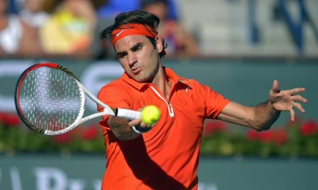 Roger Federer, of Switzerland, returns a shot to Ivan Dodig, of Croatia, during their match at the BNP Paribas Open tennis tournament, Monday, March 11, 2013, in Indian Wells, Calif. (AP Photo/Mark J. Terrill)