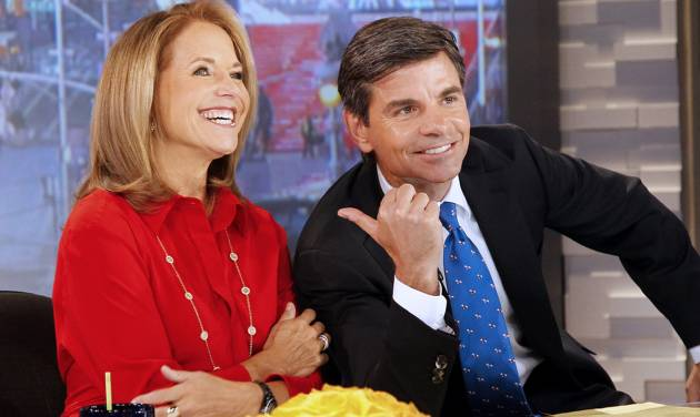 """In this photo provided by the ABC Television Network, Katie Couric, left, co-hosts with George Stephanopoulos on """"Good Morning America,"""" Monday, April 2, 2012, at the ABC studio in New York. While Robin Roberts is on vacation, Couric returns to morning television as a guest host on GMA. (AP Photo/(ABC, Lou Rocco)"""