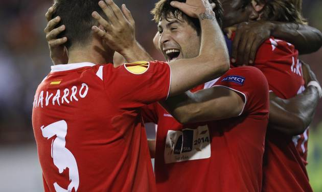 Sevilla's Coke celebrates on the end their Europa League semifinal second leg soccer match against Valencia at the Mestalla stadium in Valencia, Spain, Thursday, May 1, 2014. alencia lost 2-0 in the first leg at Sevilla. The game ended 3-1 and Sevilla qualified for the final Europa League. (AP Photo/Alberto Saiz)