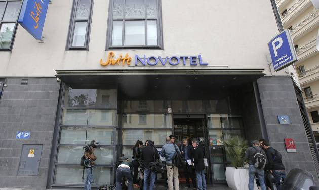 Reporters gather outside the Novotel hotel during the 66th international film festival, in Cannes, southern France, Friday, May 17, 2013. A French police official says a thief or thieves stole about $1 million worth in jewelry inside a safe in a Novotel hotel room, against the backdrop of the Riviera resort town's film festival. (AP Photo/Lionel Cironneau)
