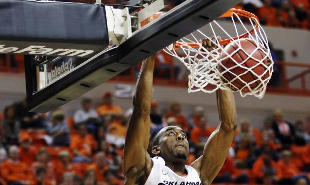 Oklahoma State guard Markel Brown dunks against Portland State in the first half of an NCAA college basketball game in Stillwater, Okla., Sunday, Nov. 25, 2012. Oklahoma State won 81-58. (AP Photo/Sue Ogrocki)