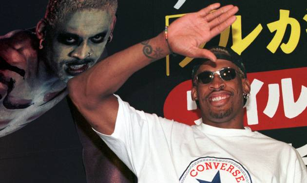 "FILE - In this July 28, 1997, file photo, former NBA basketball player Dennis Rodman waves to his fans as he arrives at a Tokyo publishing house to promote his autobiography ""Walk on the Wild Side.""  Rodman, one of basketball's most outrageous personalities, has written a book for children. The Hall of Famer's book, ""Dennis The Wild Bull,"" came out Wednesday, Jan. 30, 2013. (AP Photo/Koji Sasahara, File)"