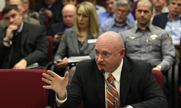 Mark Kelly, husband of former U.S. Rep. Gabrielle Giffords, testifies in favor of proposed gun control legislation in the Colorado Legislature,  at the State Capitol, in Denver, Monday March 4, 2013.  Kelly, a retired Navy captain and astronaut, has testified before Congress in support of gun control measures.   The proposal Kelly testified for would expand background checks to include private and online sales. (AP Photo/Brennan Linsley)