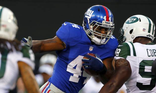 New York Giants running back Ahmad Bradshaw (44) runs against New York Jets defensive end Quinton Coples (98) during the first half of a preseason NFL football game on Saturday, Aug. 18, 2012, in East Rutherford, N.J. (AP Photo/Rich Schultz)