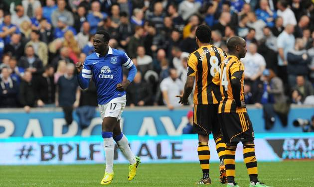 Everton's Romelu Lukaku, left, celebrates after scoring his side's second goal during their English Premier League soccer match at KC Stadium, Hull, England, Sunday, May 11, 2014. (AP Photo/Anna Gowthorpe, PA Wire)     UNITED KINGDOM OUT   -   NO SALES   -   NO ARCHIVES