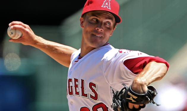 Los Angeles Angels starter Zack Greinke pitches to the Tampa Bay Rays in the second inning of a baseball game in Anaheim, Calif., Sunday, July 29, 2012. Greinke made his debut with the Angels after being traded by the Milwaukee Brewers. (AP Photo/Reed Saxon)
