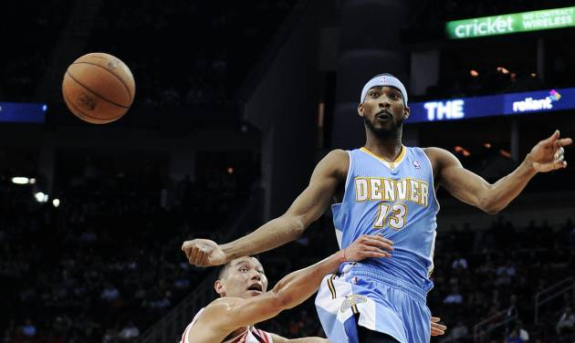 Denver Nuggets' Corey Brewer (13) passes off the ball under pressure from Houston Rockets' Jeremy Lin (7) in the first half of an NBA basketball game Wednesday, Jan. 23, 2013, in Houston. (AP Photo/Pat Sullivan)