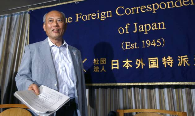 Tokyo Gov. Yoichi Masuzoe arrives at the Foreign Correspondents' Club of Japan for a press conference in Tokyo Wednesday, July 30, 2014. Masuzoe has defended his call for a review of the venue plan for the Tokyo 2020 Olympics, even if it threatens the proposal of having almost all the facilities close to the Athlete's Village. Tokyo won the right to host the 2020 Olympics with a promise to deliver a compact games with 28 of the proposed 33 competition venues within 5 miles (8 kilometers) of the village. (AP Photo/Shizuo Kambayashi)
