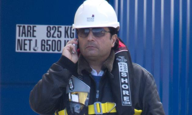 Captain Francesco Schettino talks on the phone as he waits to board the wreck of the Costa Concordia cruise ship, just off the coast of the Giglio island, Thursday, Feb. 27, 2014. The captain of the Costa Concordia has been permitted to go aboard the shipwreck for the first time since it capsized two years ago as part of a new court-ordered search. Consumer groups and lawyers for Capt. Francesco Schettino asked the court in Grosseto to authorize the searches to determine if any factors beyond human error contributed to the disaster. After searching the bridge and elevators last month, experts will examine the emergency generators Thursday. (AP Photo/Andrew Medichini)
