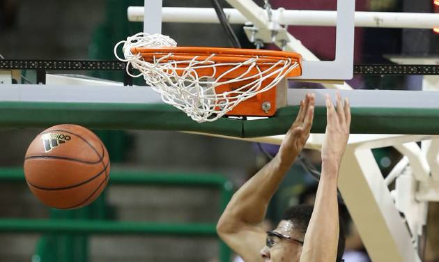 Baylor's Isaiah Austin scores over Lehigh in the first half of an NCAA college basketball game on Friday, Nov. 9, 2012, in Waco, Texas. (AP Photo/Waco Tribune Herald, Rod Aydelotte)