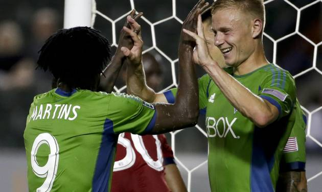 Seattle Sounders midfielder Andy Rose, right, celebrates his second goal with forward Obafemi Martins during the first half of an MLS soccer match against Chivas USA on Wednesday, Sept. 3, 2014, in Carson, Calif. (AP Photo/Chris Carlson)