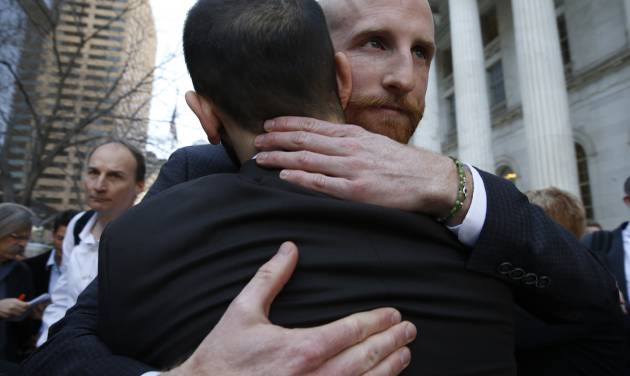 Plaintiffs challenging Utah's gay marriage ban Derek Kitchen, right, and his partner Moudi Sbeity hug after leaving court following a hearing at the U.S. Circuit Court of Appeals in Denver, Thursday, April 10, 2014. The court is to decide if it agrees with a federal judge in Utah who in mid-December overturned a 2004 voter-passed gay marriage ban, saying it violates gay and lesbian couples' rights to due process and equal protection under the 14th Amendment. (AP Photo/Brennan Linsley)