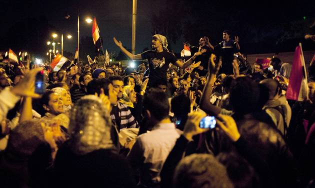 Egyptian protesters chant anti Muslim Brotherhood slogans during a demonstration in front of the presidential palace in Cairo, Egypt, Tuesday, Dec. 4, 2012. A protest by tens of thousands of Egyptians outside the presidential palace in Cairo turned violent on Tuesday as tensions grew over Islamist President Mohammed Morsi's seizure of nearly unrestricted powers and a draft constitution hurriedly adopted by his allies. (AP Photo/Nasser Nasser)