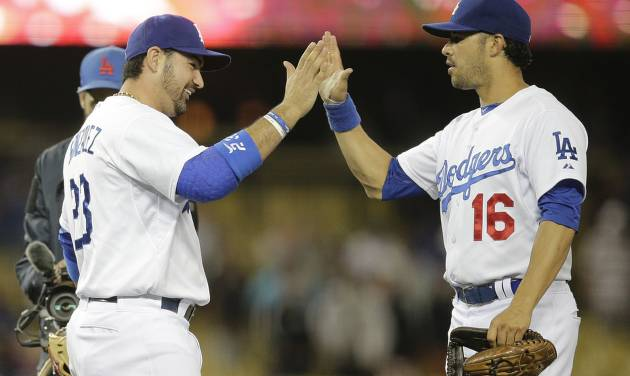 Los Angeles Dodgers' Adrian Gonzalez, left, and Andre Ethier celebrate their team's 5-2 win against the Chicago White Sox in a baseball game on Monday, June 2, 2014, in Los Angeles. (AP Photo/Jae C. Hong)