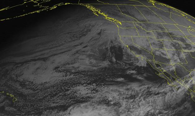 This NOAA satellite image taken Sunday, Dec. 16, 2012, at 02:00 PM EST, shows a frontal system moving into the Pacific Northwest and northern California bringing rain and heavy mountain snow. Snow will continue to fall over the Great Basin as the system moves eastward. A cold front moving south over the Northern Plains will bring snow showers. (AP Photo/Weather Underground)