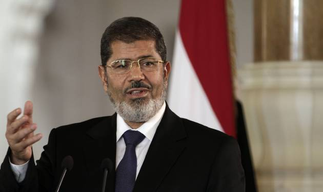 FILE - In this Friday, July 13, 2012 file photo, Egyptian President Mohammed Morsi speaks to reporters during a joint news conference with Tunisian President Moncef Marzouki, unseen, at the Presidential palace in Cairo, Egypt. An Egyptian presidential official said Saturday, Aug. 18, 2012 that President Mohammed Morsi will attend a summit of non-aligned nations in Iran end of the month, in first such visit in decades.(AP Photo/Maya Alleruzzo, File)