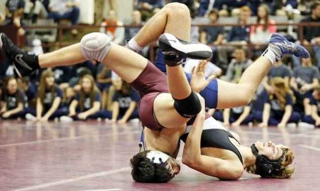 Edmond Memorial's Dylan Vana, front, and Edmond North's Bryan Creel wrestle at 152 pounds during the Three Dog Night wrestling event at Edmond Memorial High School in Edmond, Okla., Monday, Jan. 14, 2013. Photo by Nate Billings, The Oklahoman