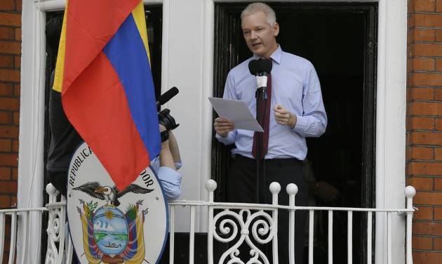 """Julian Assange, founder of WikiLeaks makes a statement from a balcony of the Equador Embassy in London, Sunday, Aug. 19, 2012. Assange called on United States President Barack Obama to end a """"witch hunt"""" against the secret-spilling WikiLeaks organization.(AP Photo/Kirsty Wigglesworth)"""