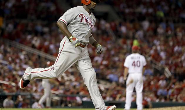 Philadelphia Phillies' Ryan Howard, left, rounds the bases after hitting a two-run home run during the sixth inning of a baseball game against the St. Louis Cardinals, Thursday, June 19, 2014, in St. Louis. (AP Photo/Jeff Roberson)