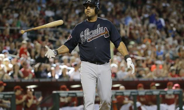 Atlanta Braves' Gerald Laird flips his bat after striking out with the bases loaded to end the eighth inning of a baseball against the Arizona Diamondbacks, Sunday, June 8, 2014, in Phoenix. (AP Photo/Matt York)